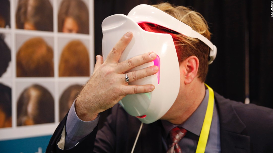 A man demonstrates the iDerma light-therapy device at CES Unveiled, a tech event in Las Vegas on Monday, January 4. The device uses low-level light to treat skin conditions.