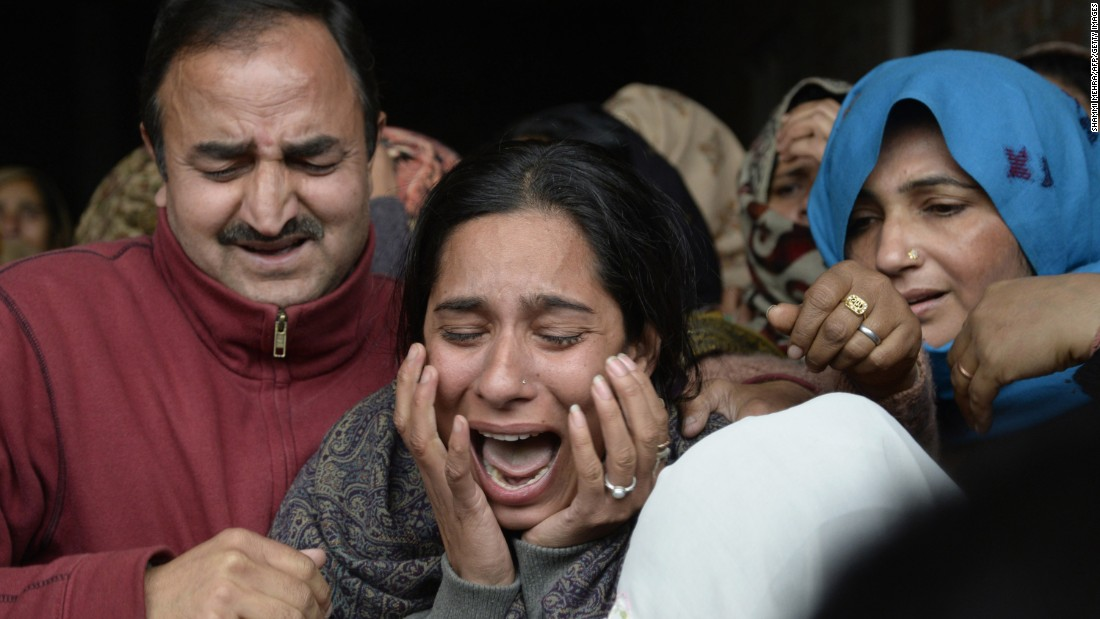 Madhu Radha, daughter of Indian soldier Fateh Singh, cries after seeing his body at his funeral Monday, January 4, in Jhanda Gujjran, India. Singh was killed when an air force base was attacked by suspected Islamic insurgents.
