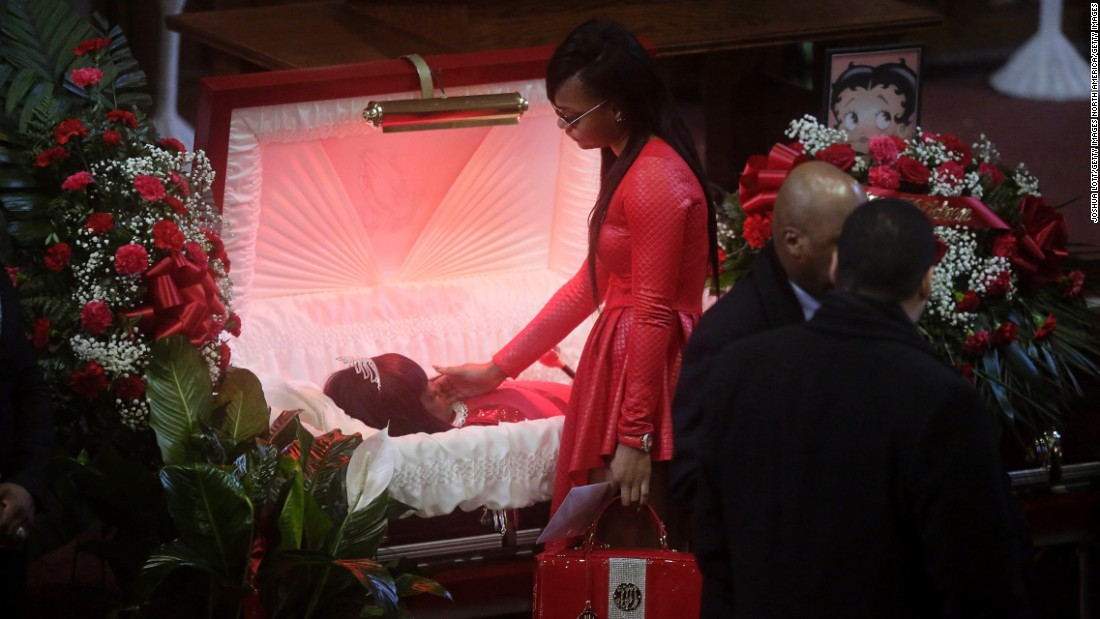 "LaTonya Jones stands over her mother, Bettie, during her funeral in Chicago on Wednesday, January 6. Police said Bettie Jones, 55, <a href=""http://www.cnn.com/2015/12/28/us/chicago-police-shooting/"" target=""_blank"">was accidentally killed by an officer</a> responding to a domestic dispute in late December."