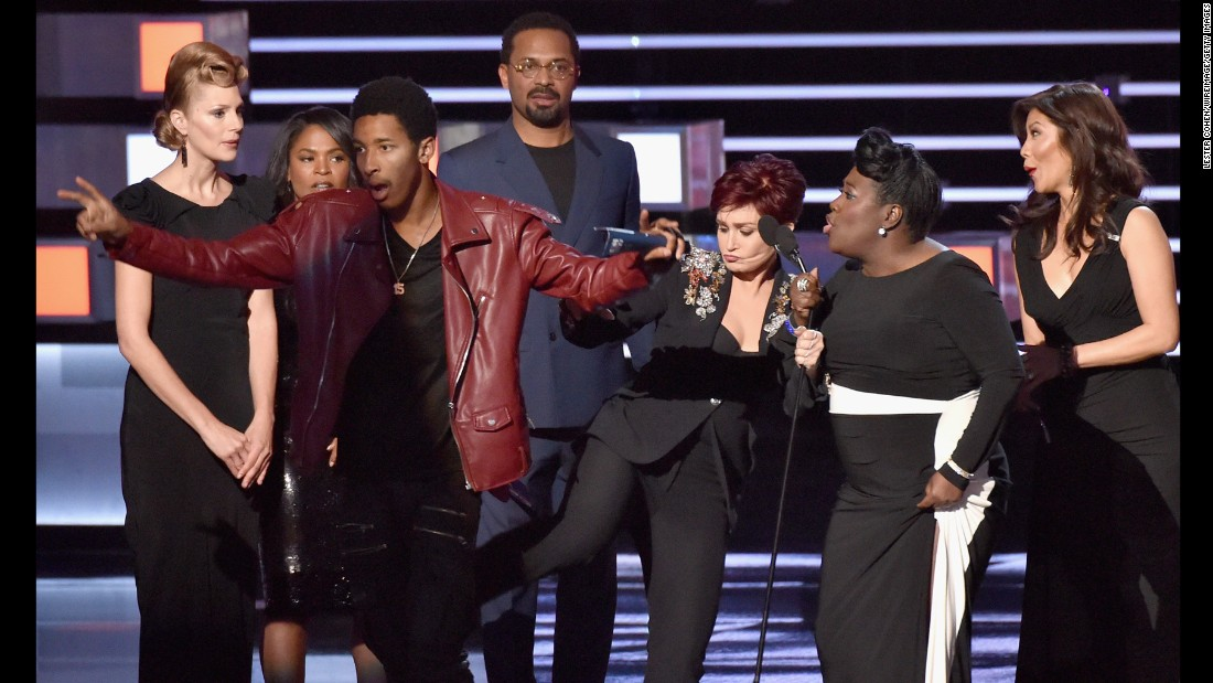 "Television personality Sharon Osbourne <a href=""http://www.cnn.com/2016/01/07/entertainment/peoples-choice-stage-crasher/"" target=""_blank"">kicks a stage-crasher</a> while she and other hosts of ""The Talk"" accept a People's Choice Award on Wednesday, January 6."