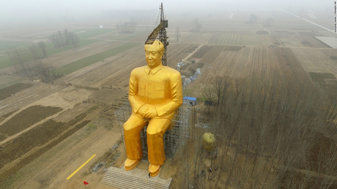 "A giant statue of former Chinese leader Mao Zedong is seen under construction near Kaifeng, China, on Monday, January 4. The gold-painted statue is 36.6 meters tall (120 feet). Days later, the <a href=""http://www.cnn.com/2016/01/09/travel/china-chairman-mao-giant-statue-henan-province-destroyed/index.html"">statue was torn down</a> because it lacked approval from authorities, according to state media."