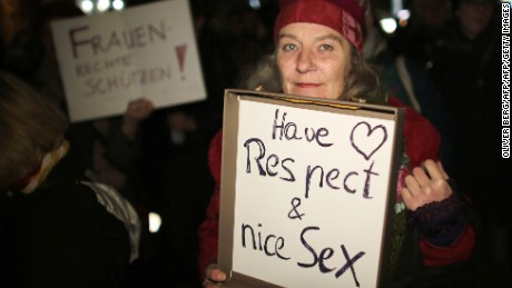 A woman holds a sign during a demonstration in Cologne after a wave of attacks on women over New Year's Eve.