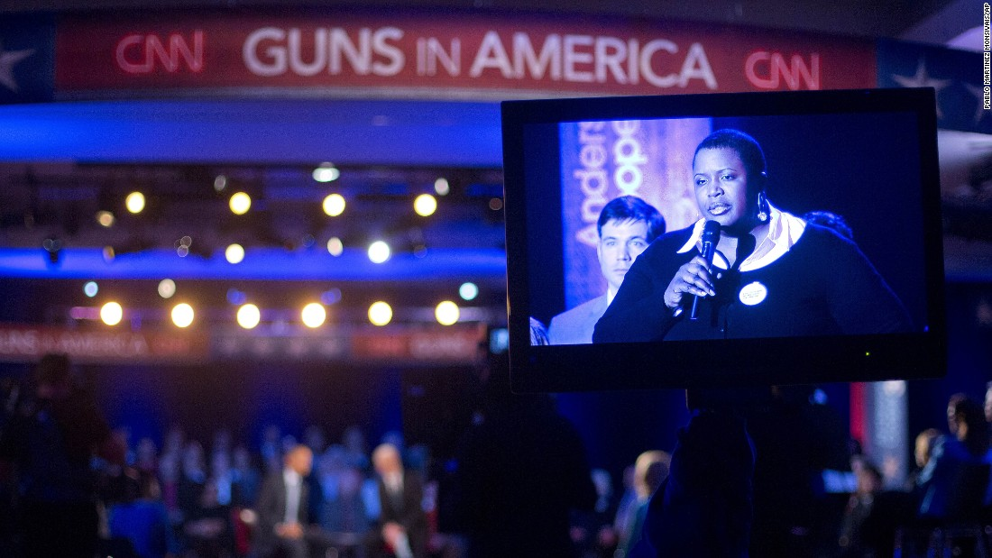 Cleopatra Cowley-Pendleton, mother of slain Chicago teen Hadiya Pendleton, is seen on a television monitor asking Obama a question.