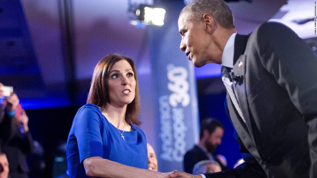 "Obama walks over to greet Taya Kyle, widow of ""American Sniper"" Chris Kyle, during a commercial break. Earlier in the meeting, she told Obama that background checks give ""almost a false sense of hope"" and wouldn't have stopped many of the mass shootings we've witnessed. She also noted murder rates are down and maybe we should ""celebrate where we are."" After thanking Kyle for her husband's service, Obama agreed that crime was down overall, but said, ""I challenge the notion that the reason for that is more gun ownership."" He compared what he's trying to do to government efforts to make cars safer. ""In the same way that we don't eliminate all traffic accidents but over the course of 20 years, traffic accidents get lower ... that's the same thing that we can do with gun ownership,"" Obama said."
