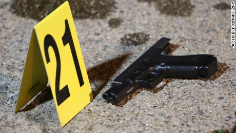 A gun sits by a marker after Thursday night's shooting in west Philadelphia.
