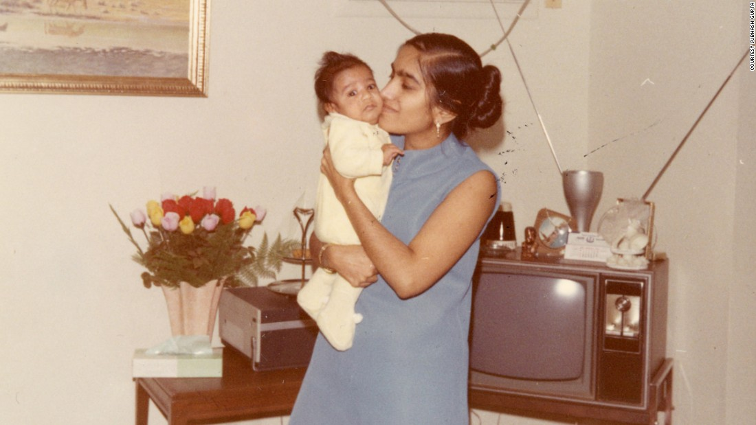 "Damyanti Gupta holds baby Sanjay at their home in Dearborn, Michigan, in 1969.<br />""The word impossible was not allowed in the Gupta household. Never. Not with a mother like mine,"" he says now."
