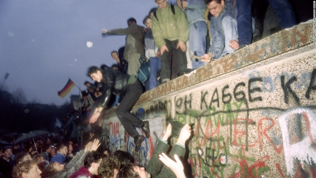 People from East Germany greet citizens of West Germany at the Brandenburg Gate in Berlin on December 22, 1989 as the border was opened. Bundesliga clubs rapidly lured away BFC's best players.