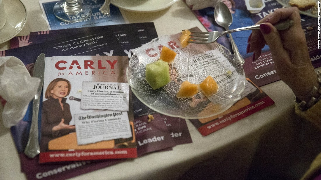 Campaign brochures for Republican presidential candidate Carly Fiorina sit on a table next to an attendee eating after Fiorina spoke in Manchester, New Hampshire, on Tuesday, January 5.