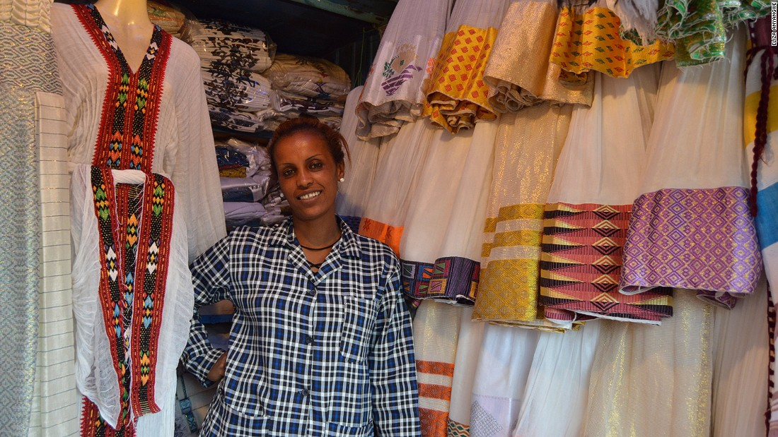 A trader in Shiro Meda, Addis's large market for traditional clothes and souvenirs, poses with her wares. Always go ready to haggle hard.