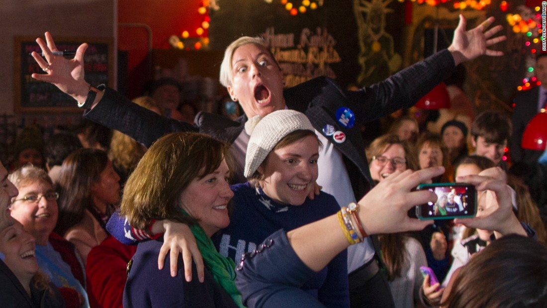 "Around 200 people crowded into a New Hampshire restaurant in January to see retired soccer star Abby Wambach (arms outstretched) and actress Lena Dunham (wearing the hat). Both <a href=""http://www.cnn.com/2016/01/08/politics/hillary-clinton-lena-dunham-abby-wambach/"" target=""_blank"">endorsed Hillary Clinton.</a> <br /><br />""I'm embarrassed to say this, but it took me far too long to start voting,"" Dunham told the crowd. ""I had been of legal age for more than four years before I cast my first vote in the 2008 presidential election. It's not that I didn't care, but I didn't believe that me caring mattered. It was impossible for me to comprehend that one young woman checking a box after waiting in a long line could matter on a national level."""