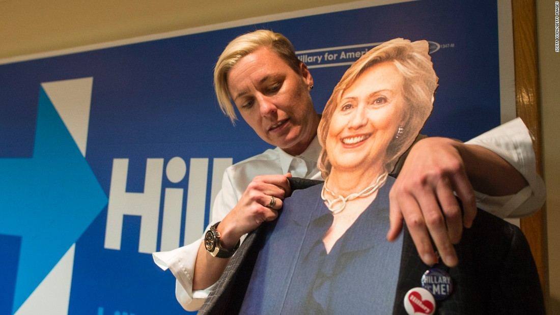 Former U.S. Women's National Soccer Team captain Abby Wambach puts her jacket on a cardboard cutout of Clinton before speaking to a crowd at a Clinton campaign office on January 8, 2016 in Salem, New Hampshire.