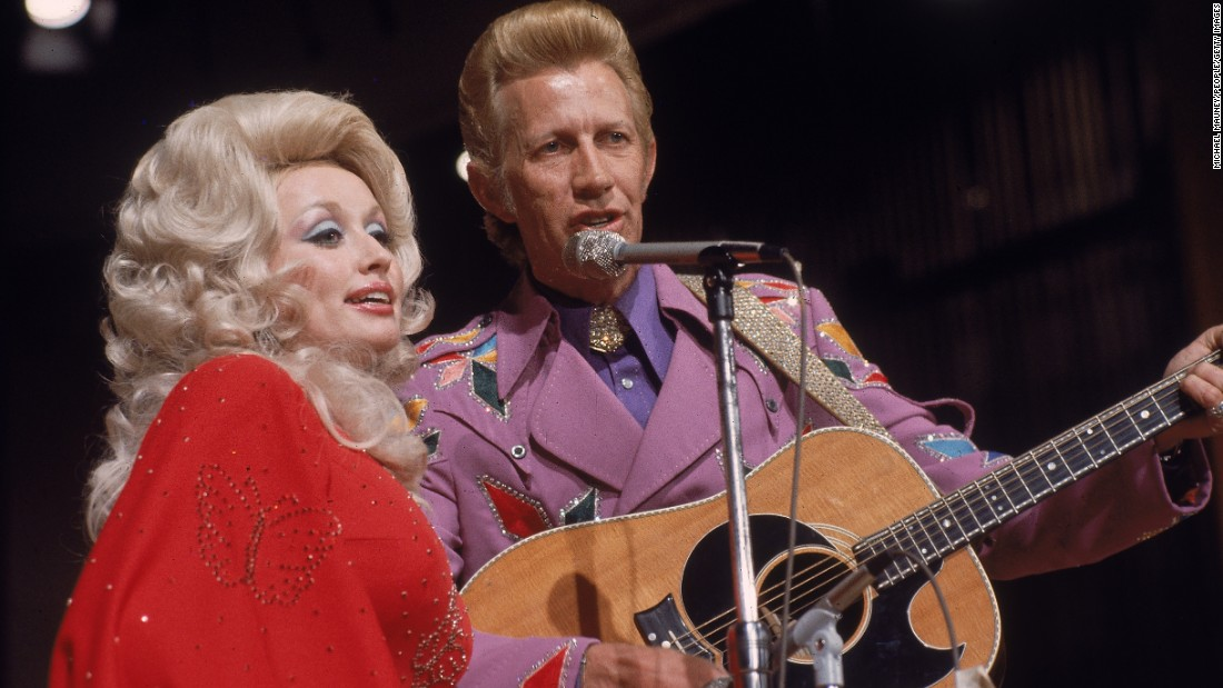 "Dolly Parton turns 70 on Tuesday, January 19. The performer has had a storied singing career, both as a solo artist and in duets and groups. In fact, she essentially broke through to large audiences with Porter Wagoner, right, who gave her airtime on his TV program and recorded several duets with her. Parton wrote one of her most popular songs, ""I Will Always Love You,"" about Wagoner. Click through the gallery for more of Parton's partners."