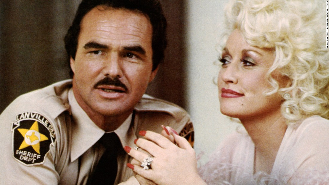 "Parton had teamed with Burt Reynolds two years earlier. In ""The Best Little Whorehouse in Texas,"" based on the hit stage musical, Parton played a madam and Reynolds played a small-town sheriff. The pair duetted on ""Sneakin' Around."""