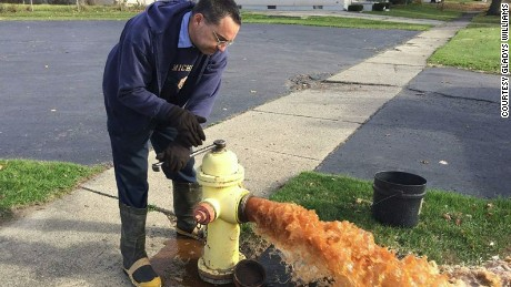 A city employee flushes out a hydrant.