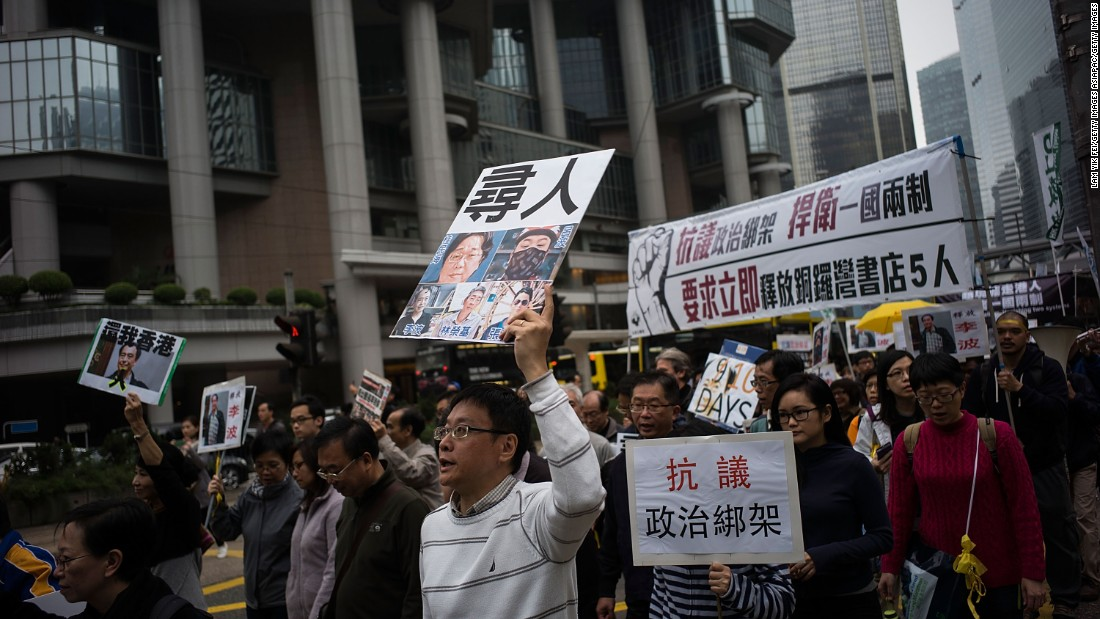 Thousands of people march through central Hong Kong Sunday, January 10, protesting the disappearance of five Hong Kong booksellers from the Mighty Current publishing house best known for books critical of Beijing.