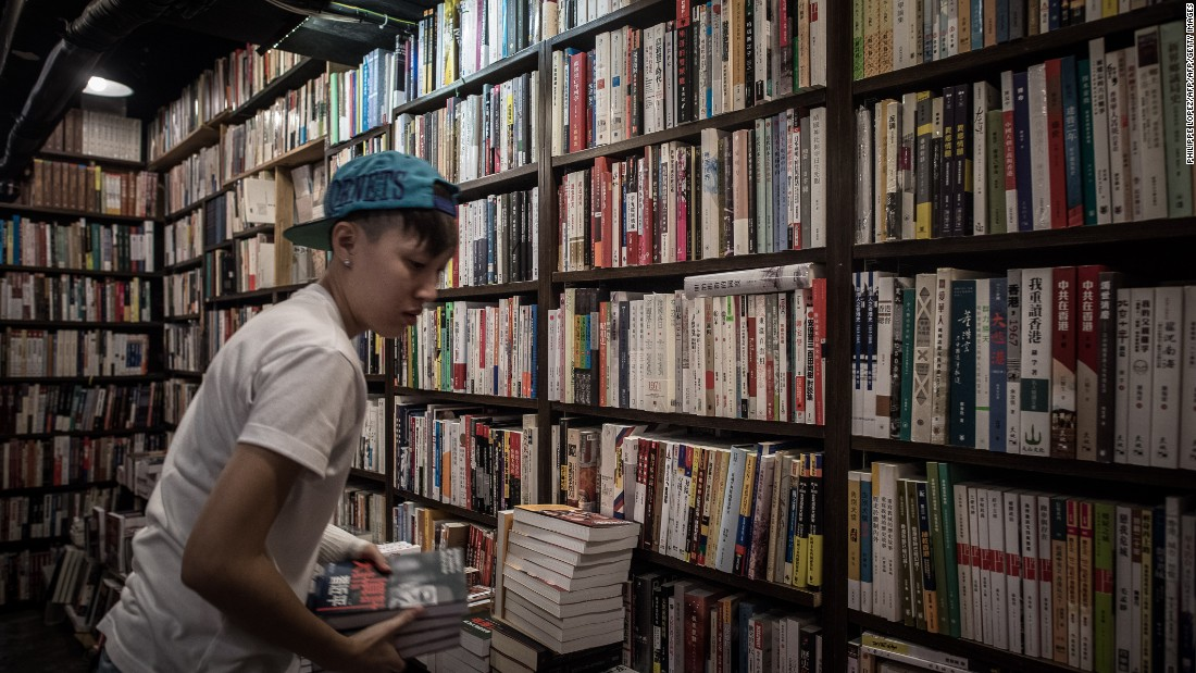 An employee arranges books about China politics in a books store in Causeway Bay district in Hong Kong on January 5, 2016.