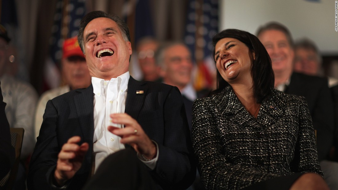Former Massachusetts Gov. Mitt Romney and Haley laugh during a rally on January 13, 2012, on Hilton Head Island, South Carolina.