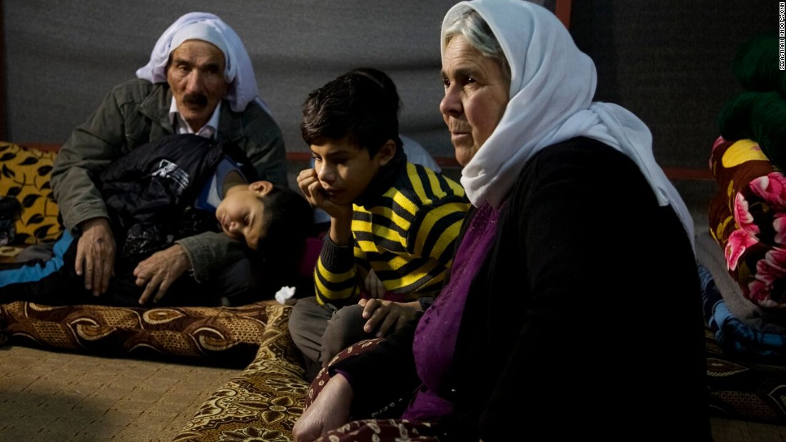 Nouri, 11, rests with his grandparents after escaping from captivity while his 5-year-old brother Saman sleeps.