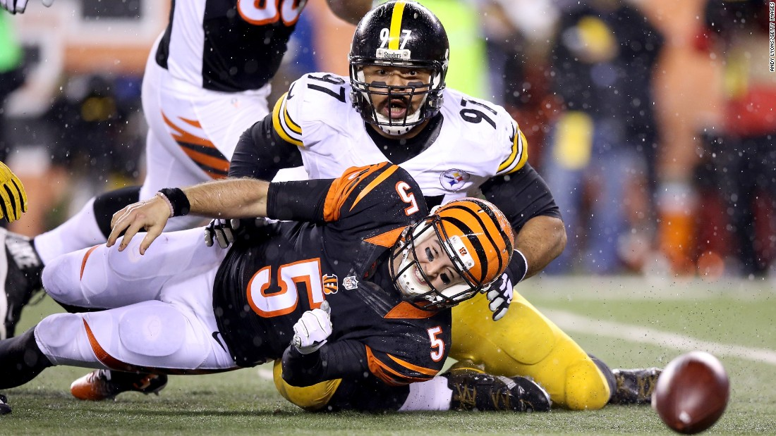 Cincinnati quarterback A.J. McCarron (No. 5) fumbles after being sacked by Pittsburgh's Cameron Heyward during an NFL playoff game in Cincinnati on Saturday, January 9. Pittsburgh won 18-16 to deny the Bengals their first playoff win in 25 years.