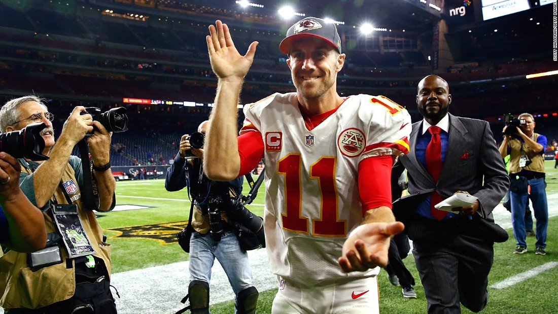 Kansas City quarterback Alex Smith walks off the field in Houston after his Chiefs blew out the Texans 30-0 on Saturday, January 9. It was Kansas City's first playoff win since 1994.