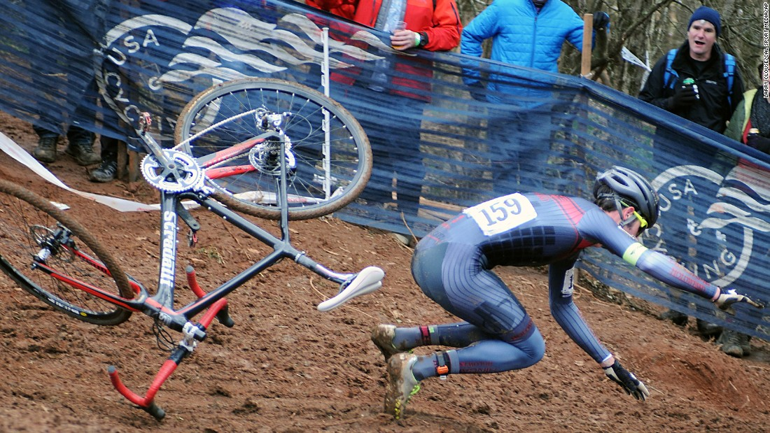 Charlie Hough falls off his bicycle Sunday, January 10, while competing in the Cyclocross National Championships in Asheville, North Carolina. He would go on to finish the race.