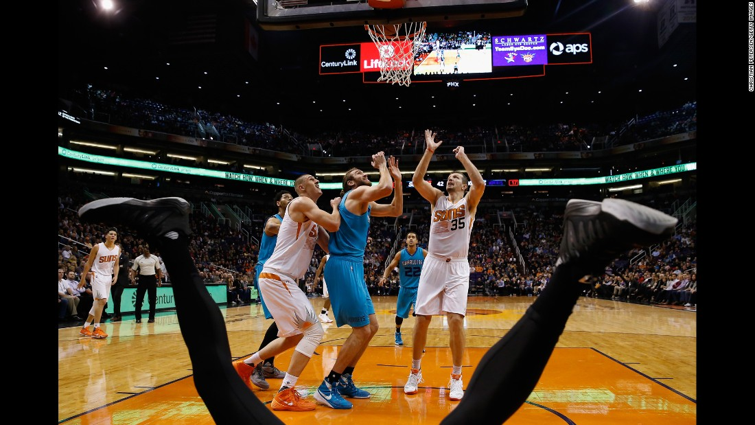 The legs of NBA player Jeremy Lamb frame this action shot from Phoenix on Wednesday, January 6. Lamb had fallen on the court during play.