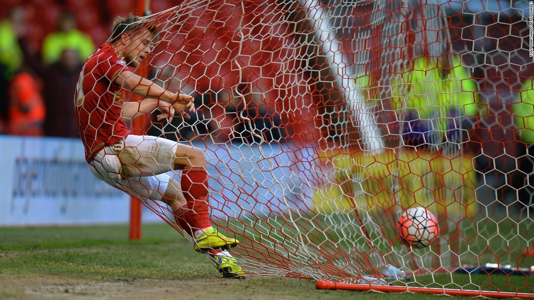 Jamie Ward gets tangled in the back of the net after Nottingham Forest teammate Oliver Burke scored against Queens Park Rangers on Saturday, January 9. It was the only goal in the FA Cup match, which was played in Nottingham, England.