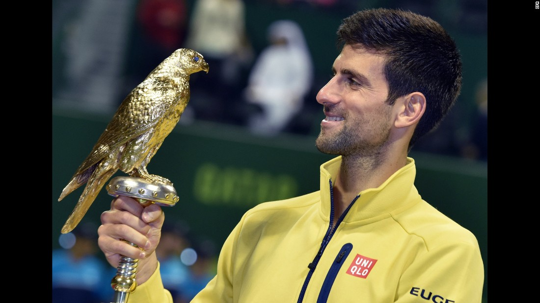 Novak Djokovic, the world's top-ranked tennis player, holds his trophy after winning the Qatar Open on Saturday, January 9.