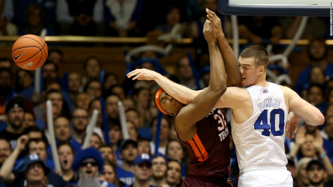 Duke's Marshall Plumlee, right, tips the ball away from Virginia Tech's Zach LeDay during a college basketball game in Durham, North Carolina, on Saturday, January 9.
