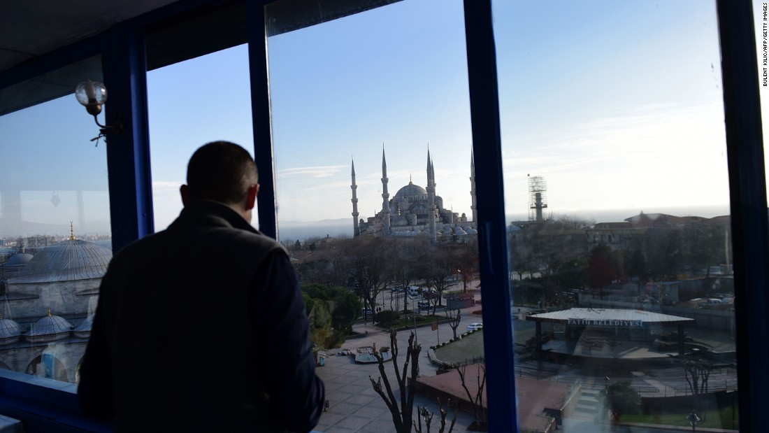 A man looks at the Blue Mosque near the site of the blast in Istanbul.