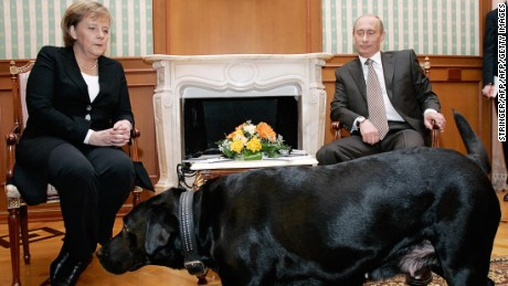 Germany's Angela Merkel watches uneasily as Putin's dog Koni approaches in 2007.