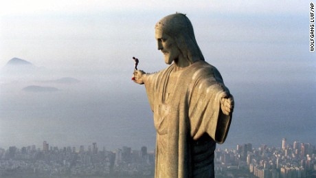 30 year-old Austrian parachutist Felix Baumgartner prepares to jump from the arm of the giant Jesus statue above the Brazilian metropolis Rio de Janeiro, Wednesday, Dec. 1, 1999.