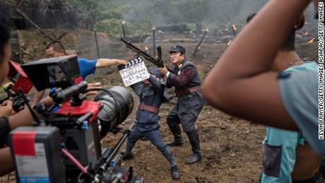 A war film is shot in Hengdian, China  on August 11, 2015.