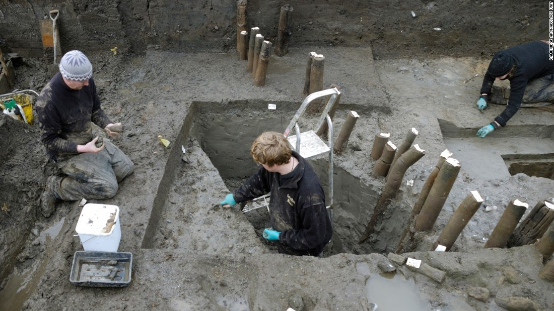 A recent excavation in eastern England has unearthed what is believed to be the best-preserved Bronze Age village found in Britain. Pictured is the excavation of the structure's palisade -- posts encircling the dwelling site -- during the exploratory investigation in 2006.