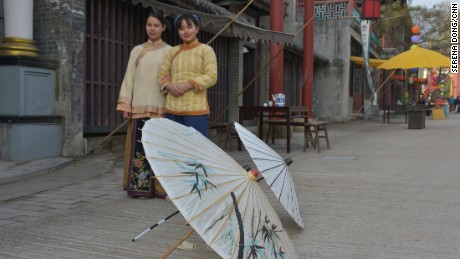 Two actresses walk through a set at Hengdian World Studios when CNN visited on December 29, 2015.