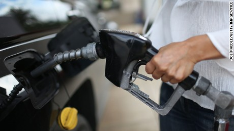 MIAMI, FL - OCTOBER 19:  Angela Prada fills her vehicle with gas at a U-Gas station on October 19, 2015 in Miami, Florida. As gas prices remain low across the nation, a recent study released by JPMorgan Chase Institute, indicates that as American consumers have more income to spend they use some of that money to purchase higher-octane gas that costs more thus negating the money saved even as gas prices remain low.  (Photo by Joe Raedle/Getty Images)
