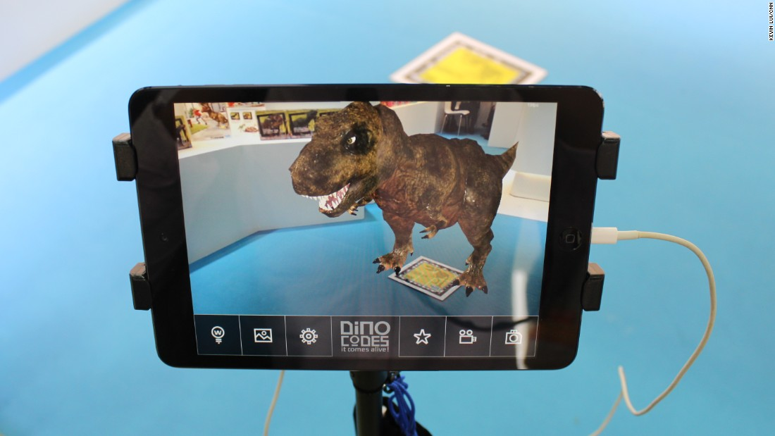 ...only to find a DNA barcode, which triggers -- in the manufacturer's complementary mobile app -- an animation of the same dinosaur whose bones you've just excavated. The app allows players to take photos and videos posing with the computer-generated creature.