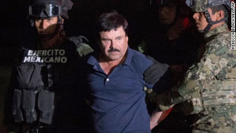 "Mexican drug lord Joaquin ""El Chapo"" Guzman is escorted by army soldiers  to a waiting helicopter, at a federal hangar in Mexico City, Friday, Jan. 8, 2016.  (AP Photo/Rebecca Blackwell)"