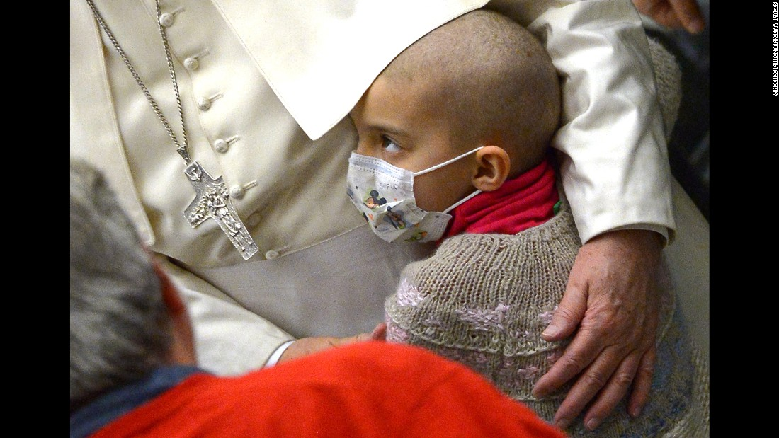 Pope Francis embraces a sick child at the Vatican on Wednesday, January 13.