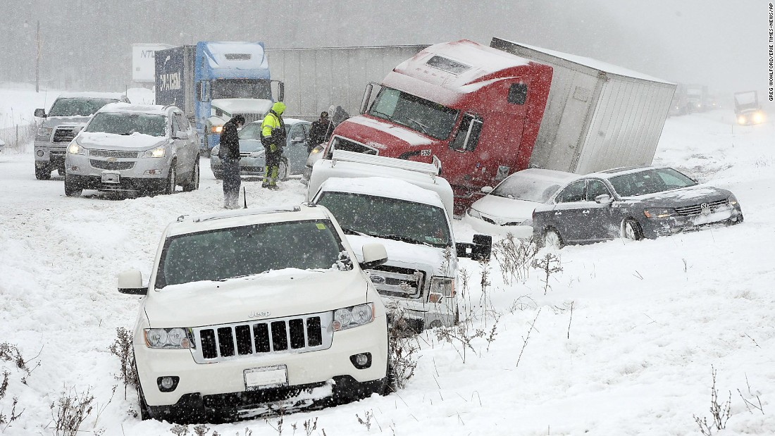 Numerous vehicles rest in a ditch in Harborcreek Township, Pennsylvania, after they were involved in a weather-related crash that closed the eastbound lanes of Interstate 90 on Wednesday, January 13.