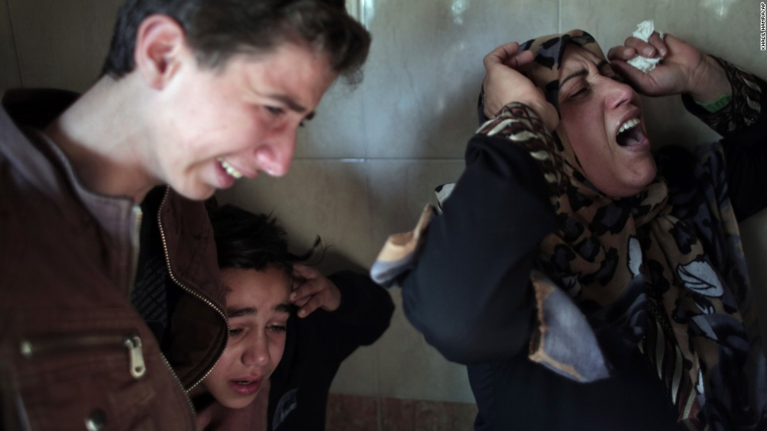 Relatives of Moussa Zuaiter, a 24-year-old Palestinian, weep during his funeral Wednesday, January 13, in a Gaza refugee camp. Zuaiter was killed by an airstrike that the Israeli military said it carried out against a group of Gaza militants placing explosives along the border.