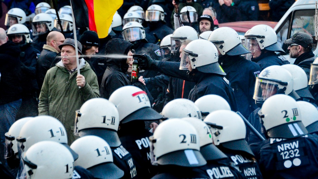 "Police in Cologne, Germany, use pepper spray during clashes with right-wing protesters on Saturday, January 9. The protesters were angry about <a href=""http://www.cnn.com/2016/01/09/europe/germany-new-year-violence/"" target=""_blank"">a spate of sexual assaults and robberies</a> during New Year's Eve festivities. Thirty-one people, most of them from North African or Middle Eastern countries, have been charged in the attacks, and this has <a href=""http://www.cnn.com/2016/01/05/europe/germany-cologne-new-year-assaults/index.html"" target=""_blank"">fueled a political firestorm over immigration in Germany.</a> About 500 of the approximately 1,700 protesters supported Pegida, an organization that opposes immigration of Muslims from the Middle East, police said."