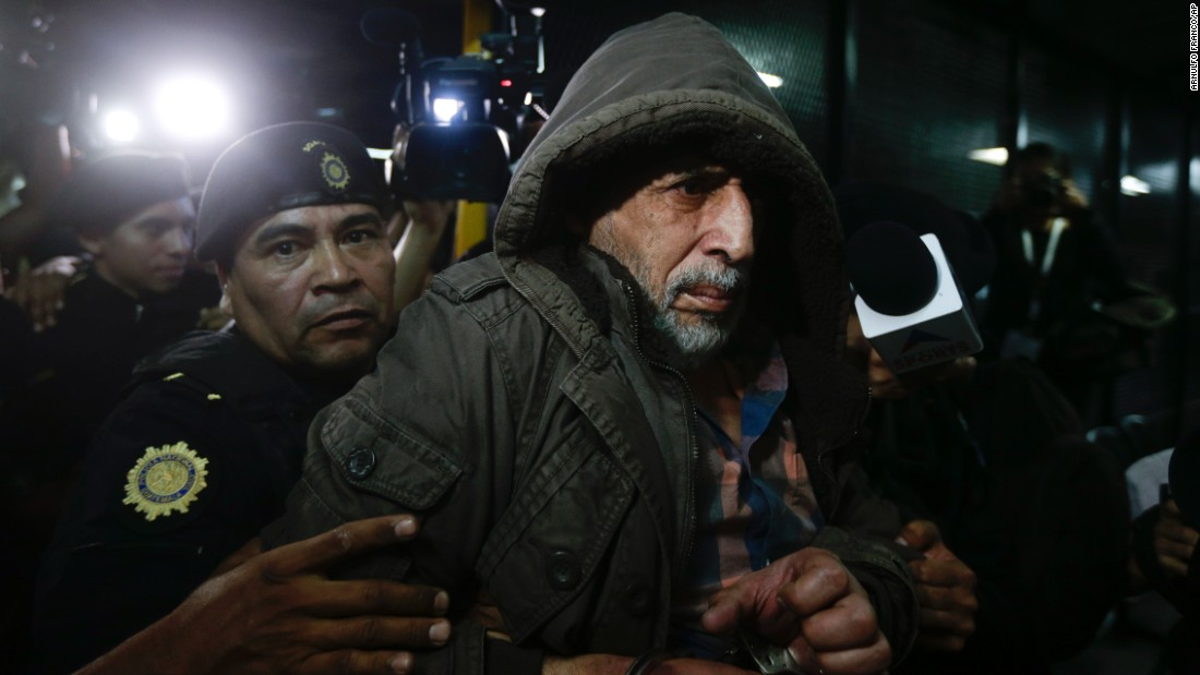 Brayan Jimenez, the former president of Guatemala's soccer federation, is taken into custody in Guatemala City on Tuesday, January 12. Jimenez has been a fugitive for a month. He faces extradition to the United States, where he could face charges of money laundering and bribery.