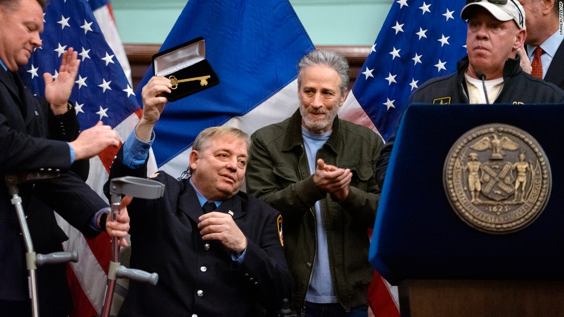 "Comedian Jon Stewart applauds Ray Pfeifer, a retired New York firefighter, after Pfeifer <a href=""http://www.cnn.com/2016/01/10/us/new-york-firefighter-ray-pfeifer-key-city/"" target=""_blank"">was given a key to the city</a> Saturday, January 9. Stewart joined New York Mayor Bill de Blasio in honoring Pfeifer, a September 11 first responder who played a key role in the passing of the Zadroga Act. The Zadroga Act, signed by President Barack Obama in 2011, expanded health coverage and compensation to first responders and those individuals who developed 9/11-related health problems. Pfeifer himself was diagnosed with stage-4 cancer that was linked to his time spent at ground zero. <a href=""http://www.cnn.com/2016/01/08/world/gallery/week-in-photos-0107/index.html"" target=""_blank"">See last week in 35 photos</a>"