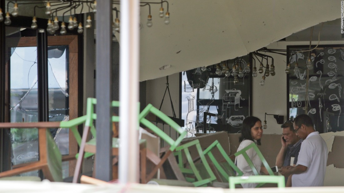 Employees inspect the damage on January 15, 2016 at the Starbucks cafe where deadly attacks occurred the day before in central Jakarta, Indonesia. ISIS claimed responsibility for the attack in an official statement posted online.