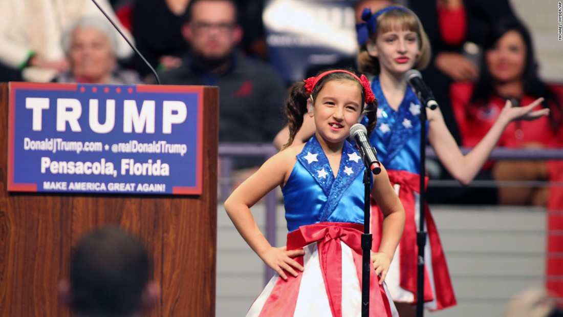 "The ""USA Freedom Kids,"" a trio of girls clad in American flag-inspired dresses, perform a dance routine in support of Donald Trump's presidential bid on Wednesday, January 13. Before Trump took the stage in Pensacola, Florida, the girls <a href=""http://www.cnn.com/2016/01/14/politics/donald-trump-usa-freedom-kids-video/"" target=""_blank"">lip synced and danced</a> along to a song that highlighted key themes Trump has talked up during his campaign -- including a sense of unapologetic, aggressive nationalism."