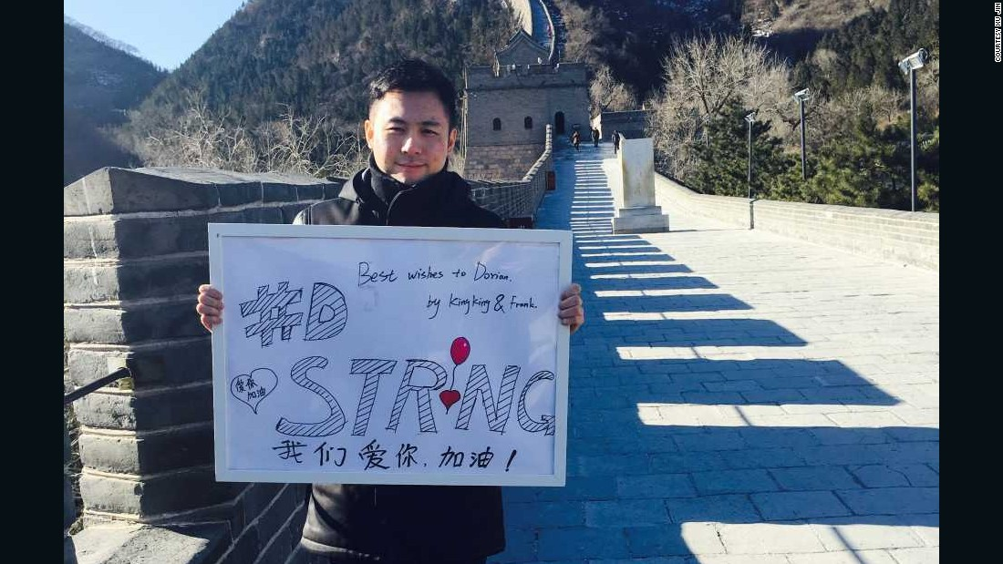 "Feng Chen, Xu's business partner, also posed with the ""#DStrong"" sign, which he drew."