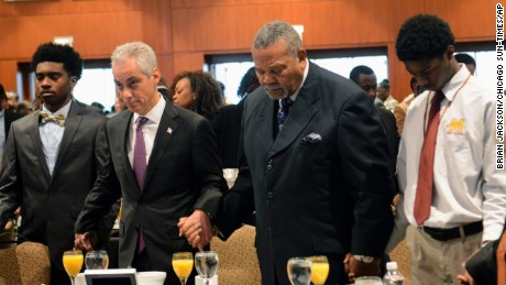 Chicago Mayor Rahm Emanuel, second from left, and the Rev. B. Herbert Martin, second from right, say a prayer during the breakfast.