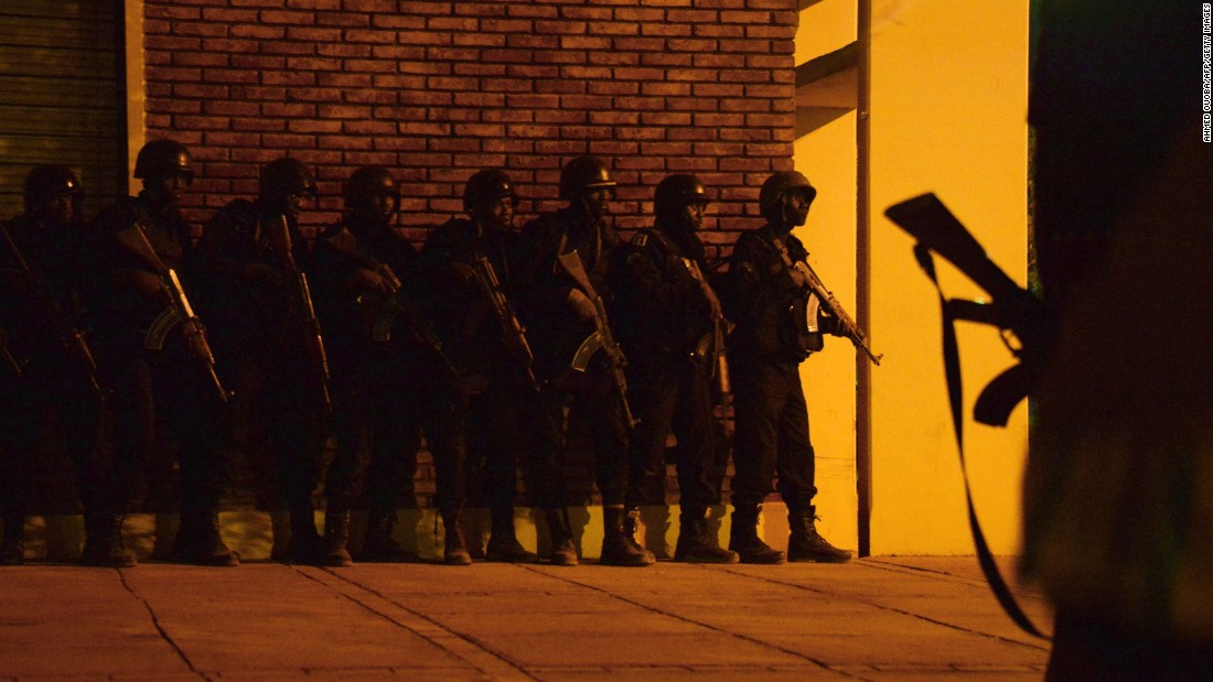Burkina Faso soldiers take position outside the hotel.