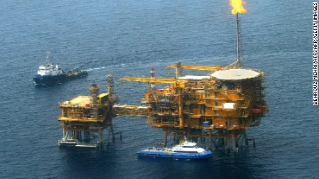Picture shows an Aerial view of the Balal offshore oil platform in the Gulf waters, in the Gulf on the edge of Qatar's territorial waters, 16 May 2004. Iran's Vice President Mohammad Ali Aref officially inaugurated the Balal offshore oil field developed by French major Total together with BowValley of Canada and Italy's Agip. The Balal field is currently producing 40,000 barrels per day and was developed under a 310-million-dollar agreement signed in 1999.      AFP PHOTO/Behrouz MEHRI (Photo credit should read BEHROUZ MEHRI/AFP/Getty Images)